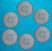 Вязание спицами салфеток: гарнитур из шести салфеток.